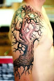 Tree of Life tattoo on arm and shoulder